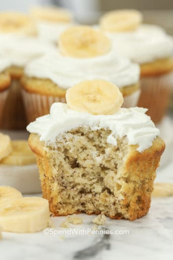 side view of banana cupcakes with a bite out of it