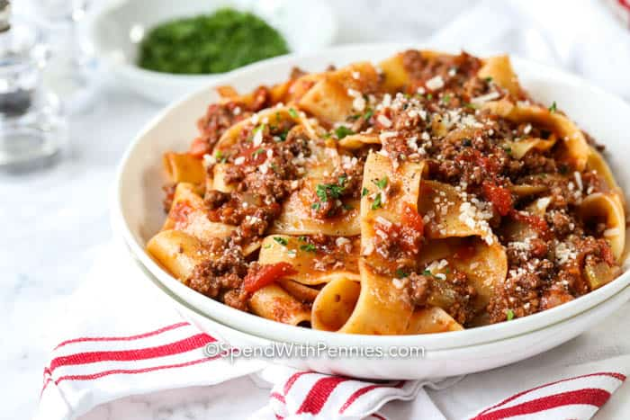 A serving of tagliatelle topped with bolognese sauce.