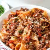 Bolognese sauce on noodles on a white plate