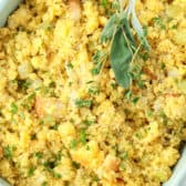 Cornbread dressing in a green dish with sage and Thyme