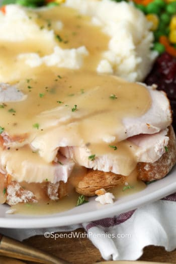 Hot turkey sandwich on a plate with gravy and mashed potatoes