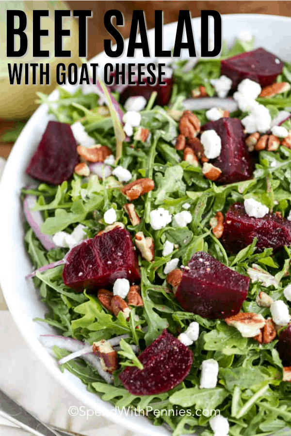 Beet Salad with goat cheese on a plate with writing
