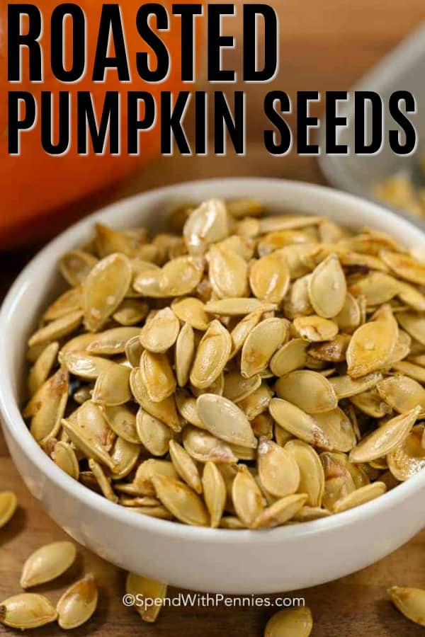 A white bowl of Roasted Pumpkin Seeds