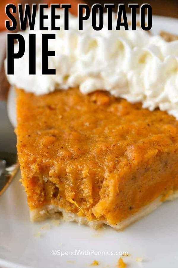 Piece of sweet potato pie on a plate with a bite taken out and writing