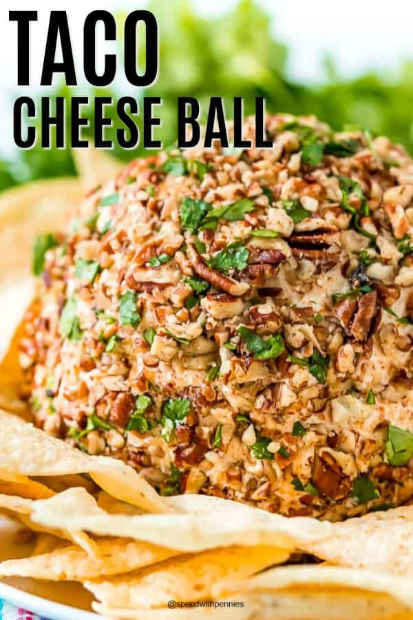 Taco cheese ball with tortilla chips and a title