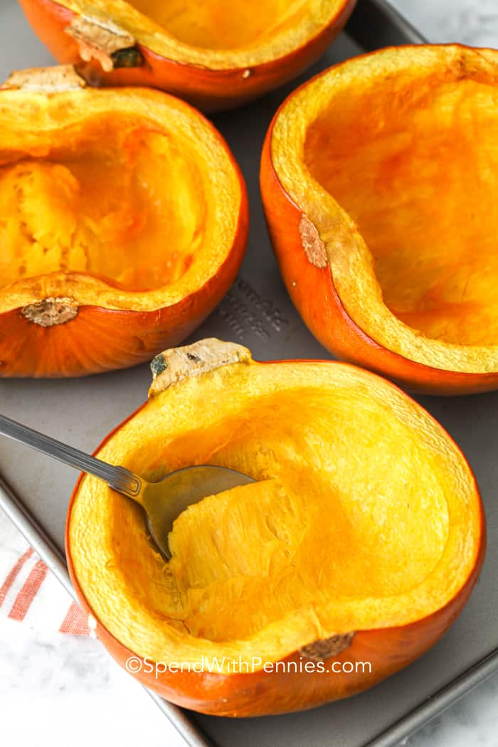 Roasted pumpkin on a sheet pan with a spoon