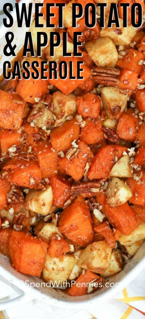 Close up overhead shot of sweet potatoes, apples and pecans mixed together with sauce in white casserole dish.