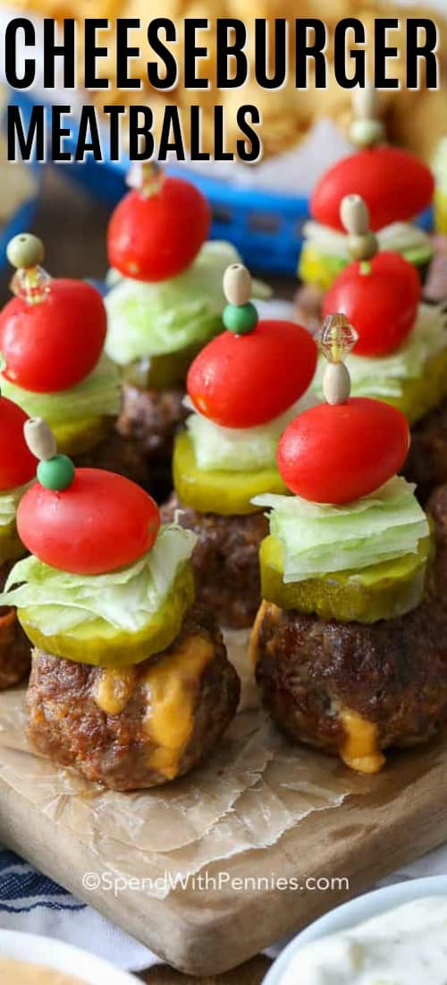 Cheeseburger meatballs on a cutting board with writing
