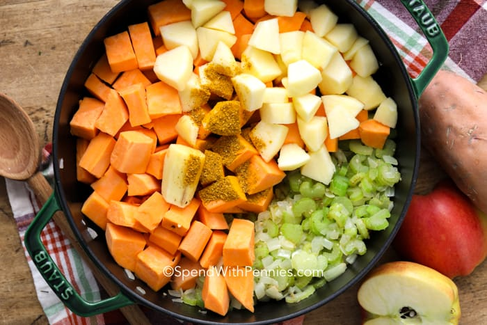 Overview of sweet potato soup ingredients in a pot.