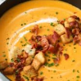Sweet Potato Soup in a pot with bacon and croutons