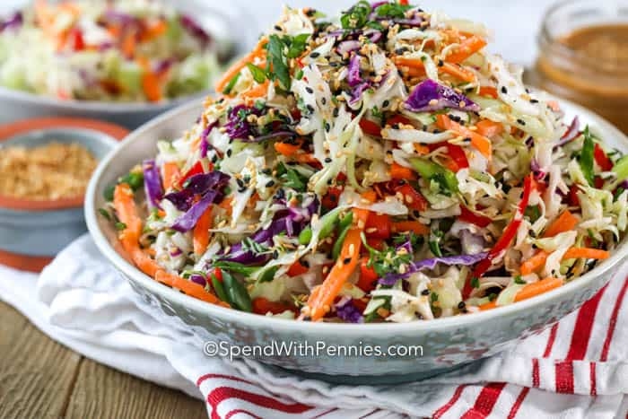 5 minute Asian slaw in a bowl garnished with sesame seeds
