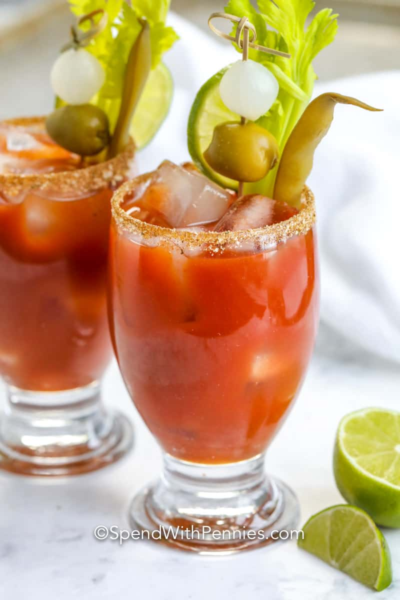 Bloody Mary's in glasses with garnishes