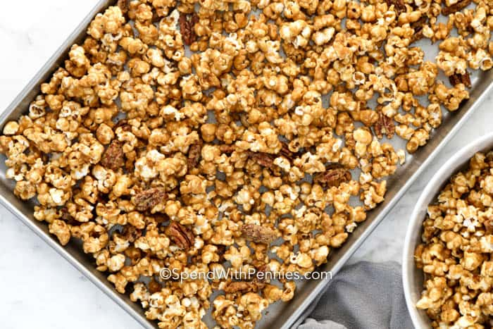 A sheet pan filled with caramel popcorn.