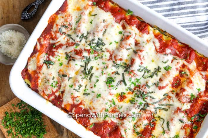 Overview of cheese cannelloni baked in a casserole dish.
