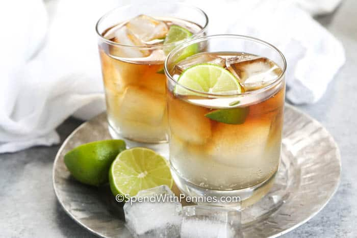 Dark and stormy cocktails in glasses with lime and ice
