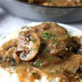 Hamburger steaks on mashed potatoes with parsley