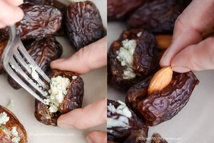 Blue cheese and almonds being stuffed into dates.