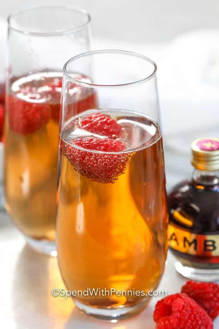 Kir Royal in glasses with raspberries