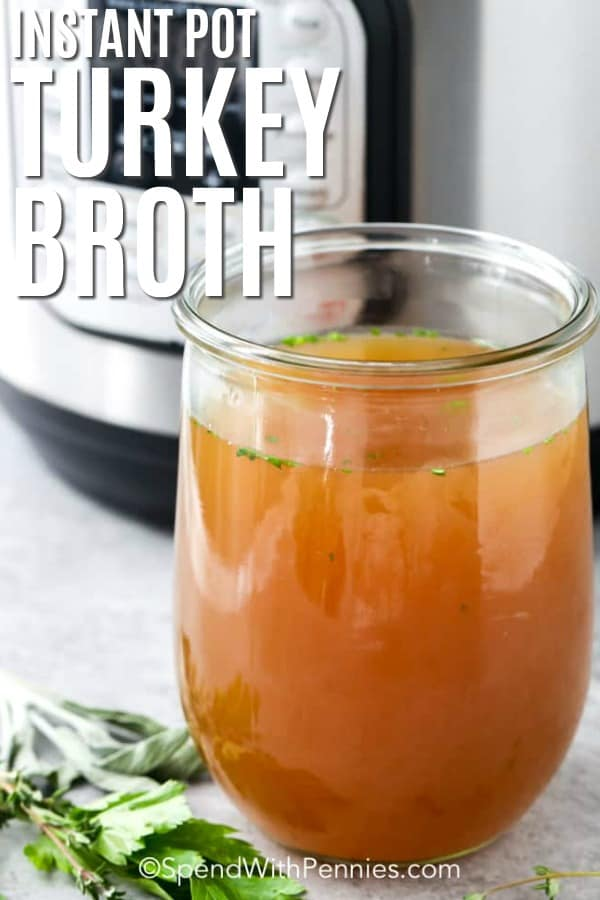 Instant pot turkey broth in a clear jar with writing