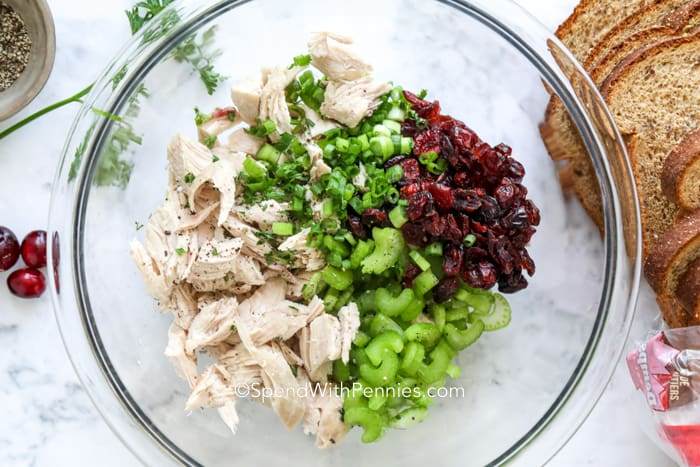 Turkey salad ingredients in a glass bowl