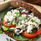 Turkey salad on a sandwich with tomato and lettuce