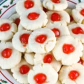 Butter cookies in a pile on a Christmas plate