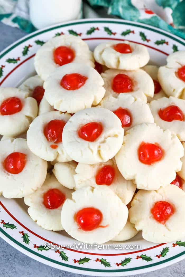 a plate full of butter cookies.