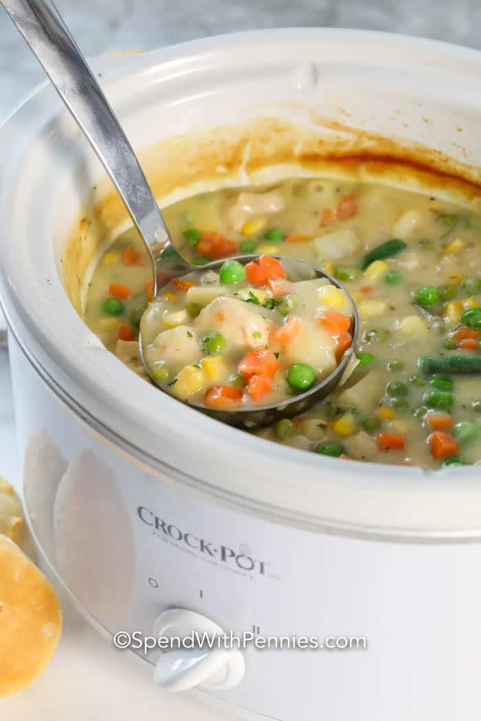 Crock pot chicken pot pie in a Crock-Pot with a ladle