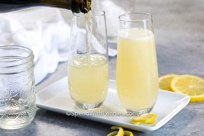 Prosecco being poured into a glass for French 75