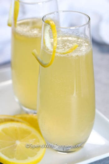 French 75 in glasses with lemon peel as garnish