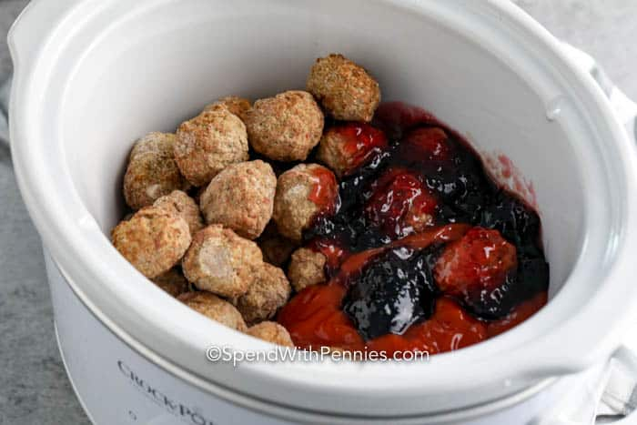Grape Jelly Meatball ingredients in a crockpot.