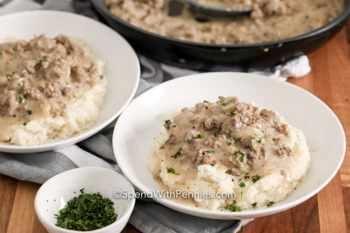 Hamburger gravy served over mashed potatoes, garnished with parsley.