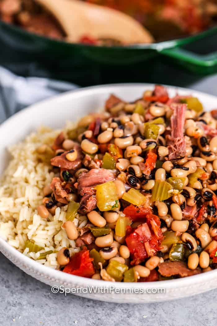 Hoppin' John served over a bowl of rice.