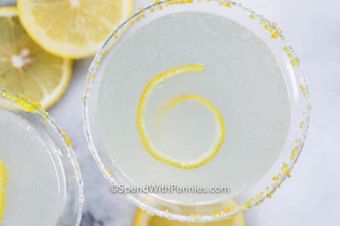 Lemon drop martini with lemons in the background