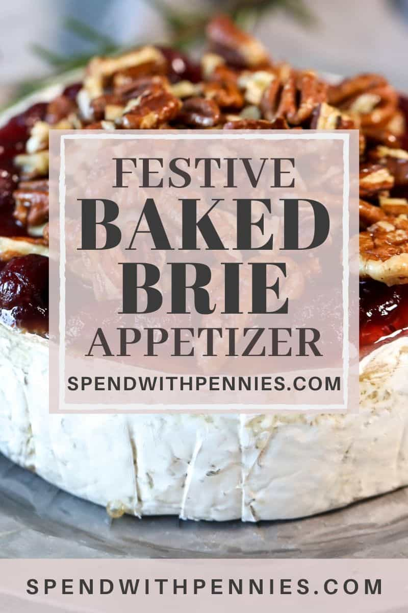 Baked Brie topped with cranberries & pecans with writing