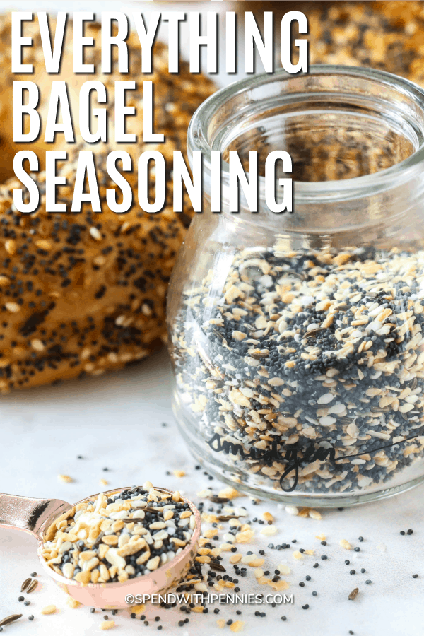 Everything bagel seasoning in a jar and in a measuring spoon with a title