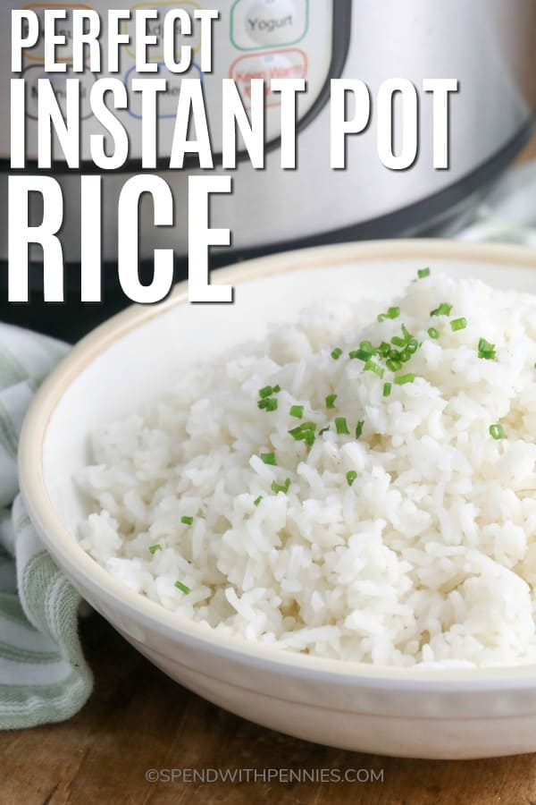 Rice in a bowl garnished with chives with writing
