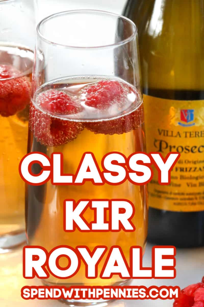 Two Kir Royale cocktails garnished with raspberries.