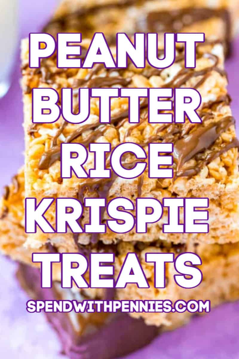 Three rice krispies treats drizzled with chocolate stacked on top of each other.