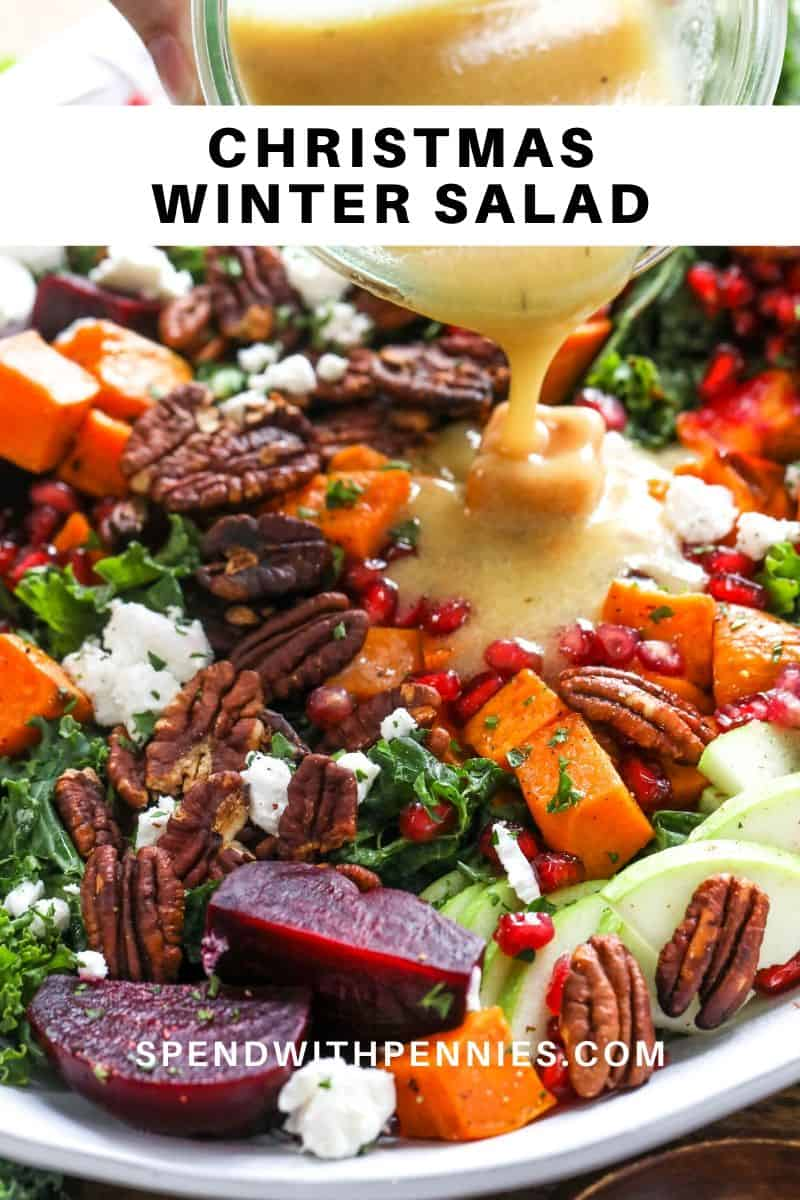Dressing being poured onto a Winter Salad.