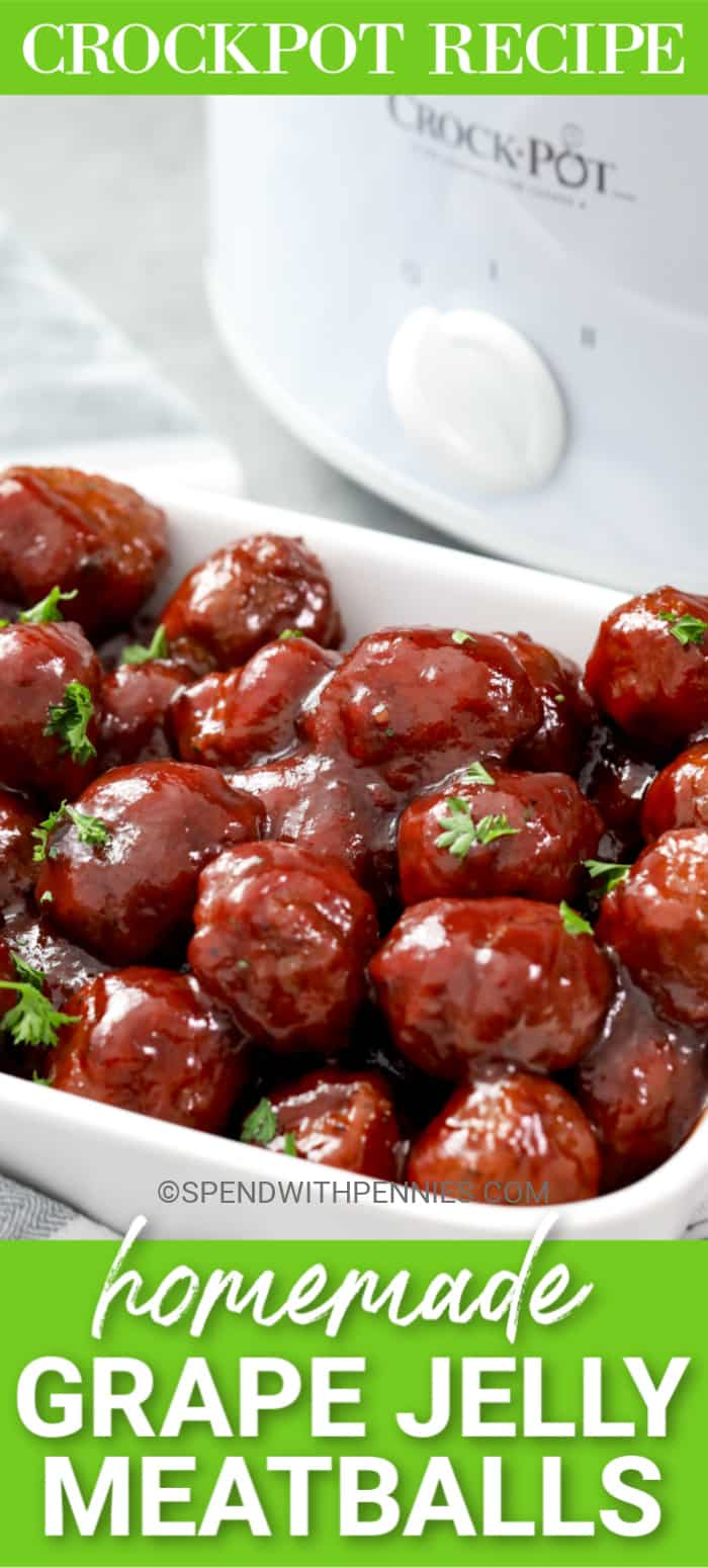 Grape Jelly Meatballs in a white serving dish with a crockpot in the background.