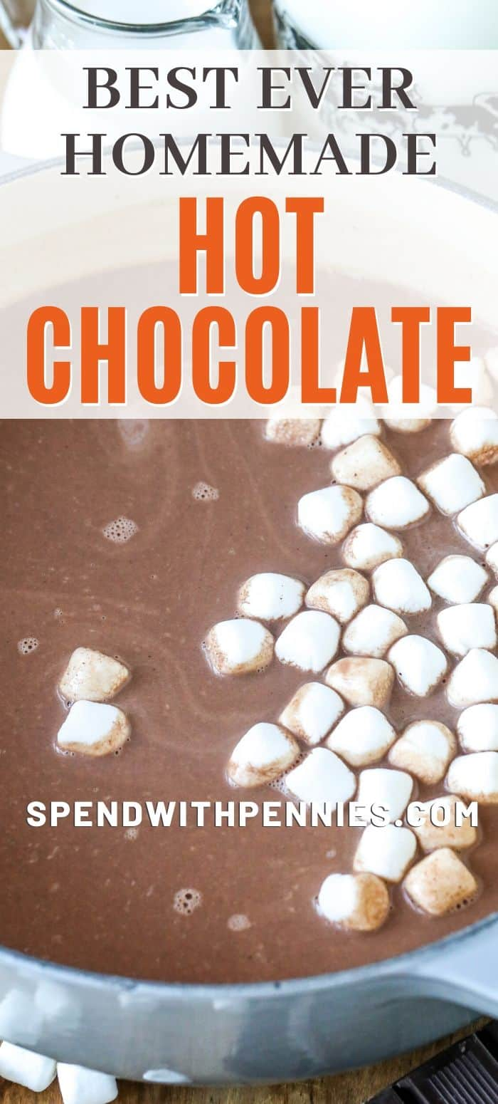Homemade hot chocolate in a pot with marshmallows and the title