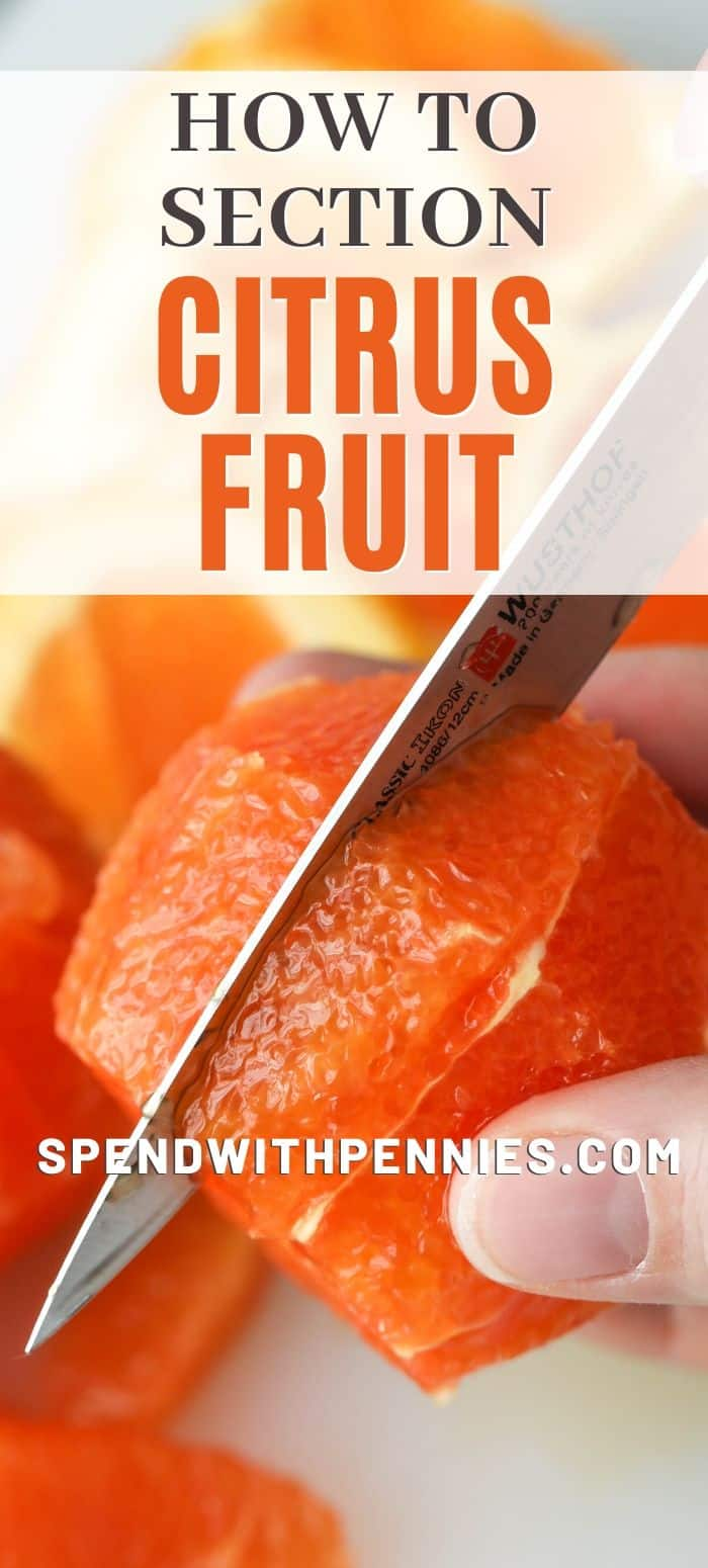 orange being cut with a knife to show how to section citrus fruit