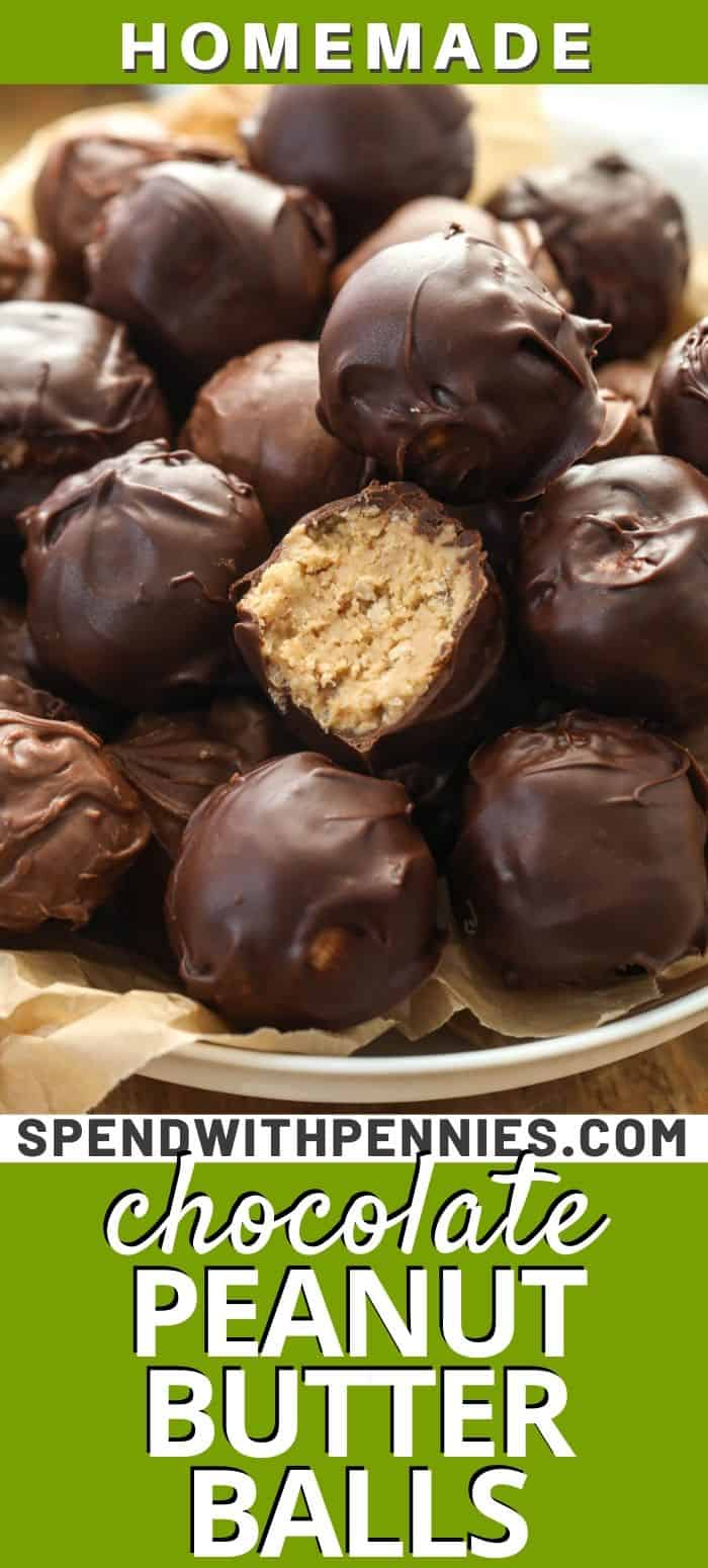 Peanut butter balls piled up on a plate.