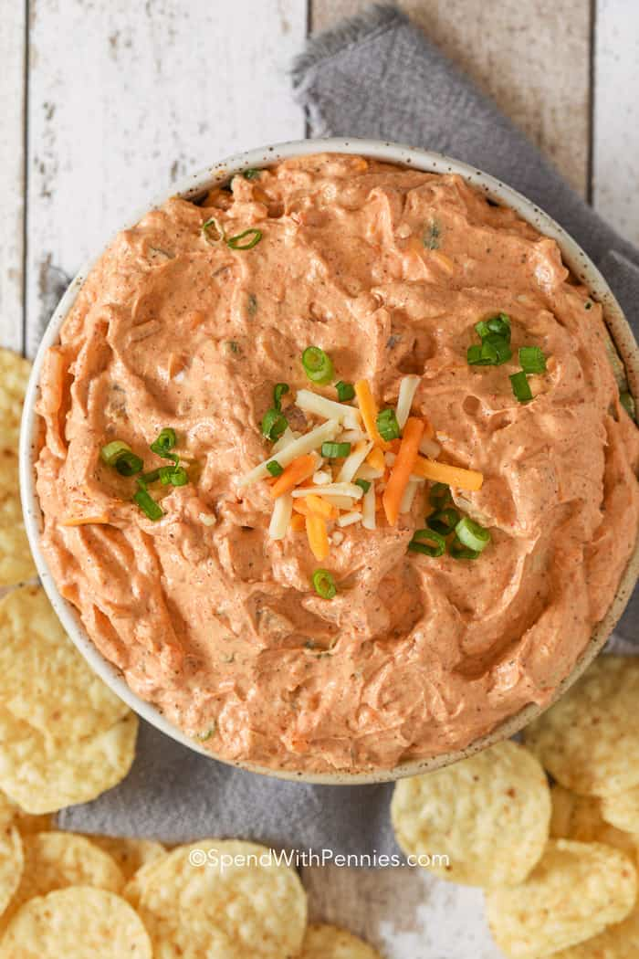 A bowl of cream cheese dip with tortilla chips ready to serve