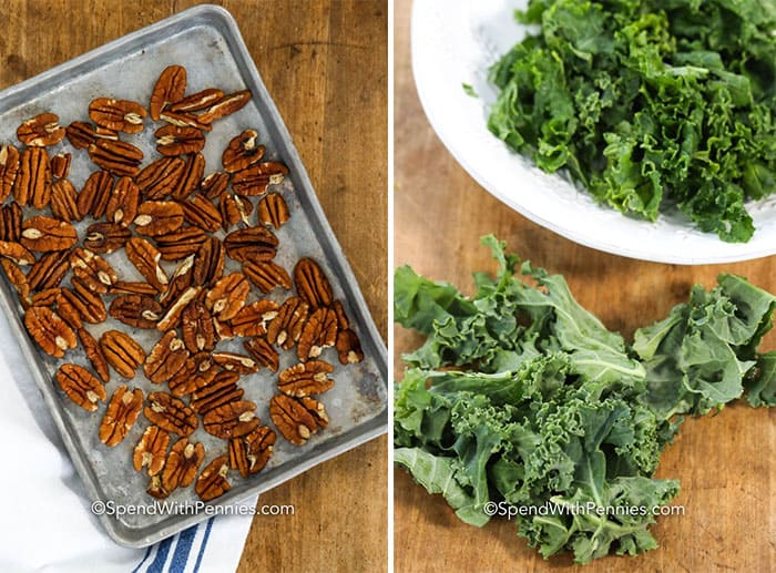 Baked pecans on a baking sheet and kale on a plate