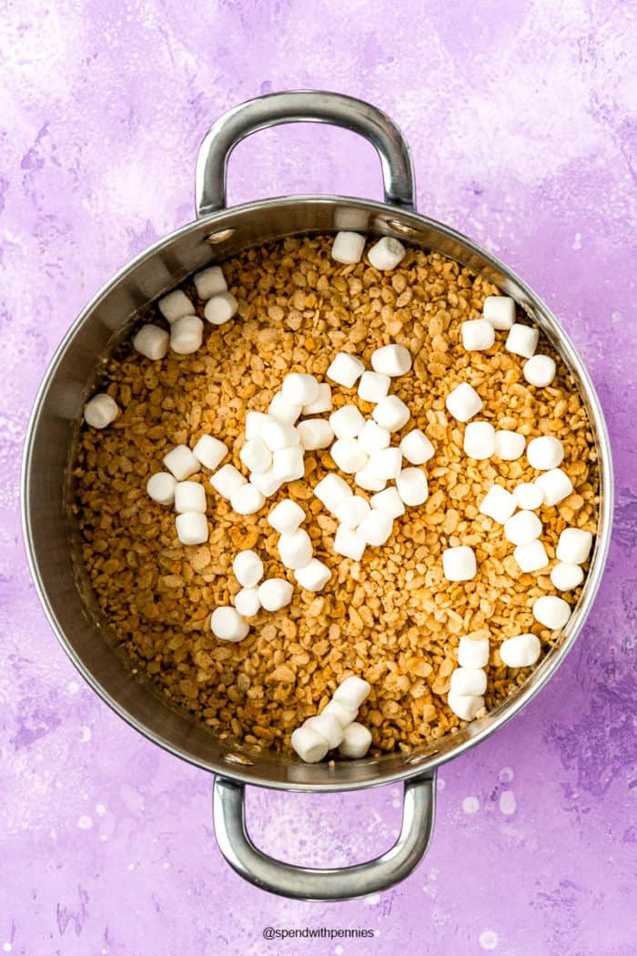 Large saucepan with ingredients to make peanut butter rice krispies treats.