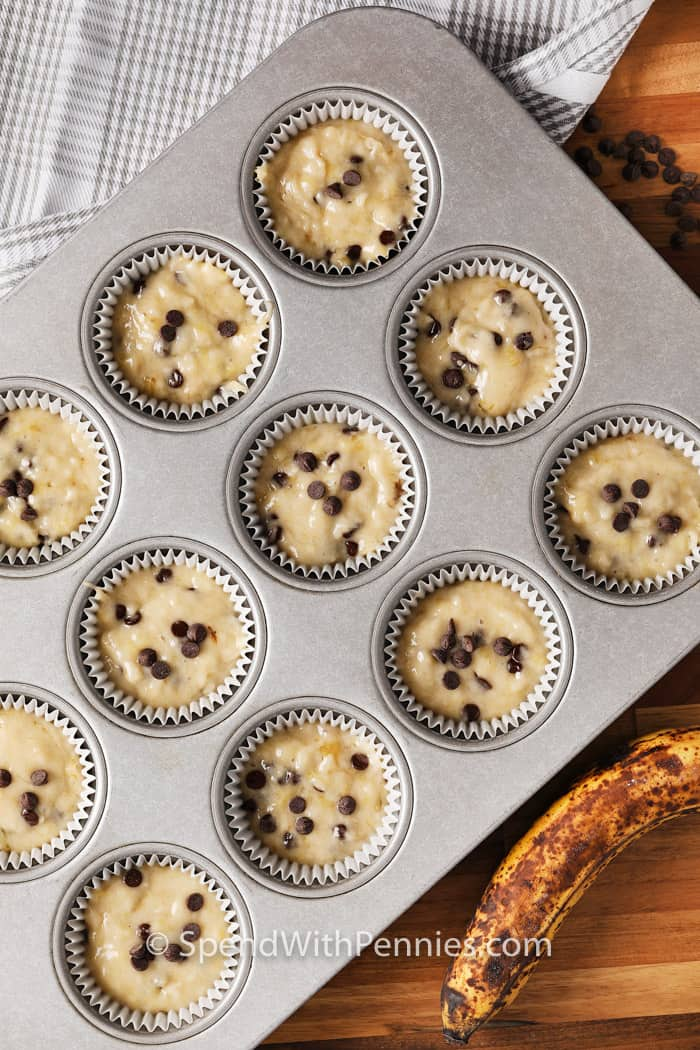 uncooked banana chocolate chip batter in a muffin tray