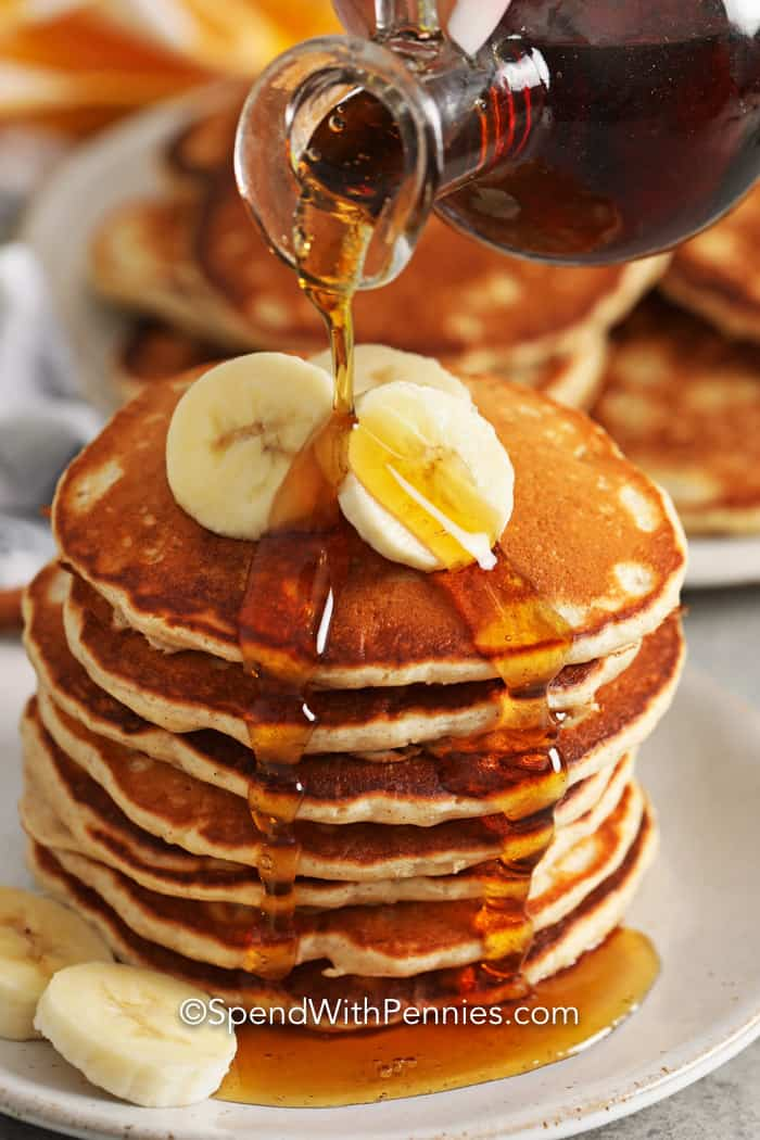 Close up of Banana pancakes with syrup pouring over it