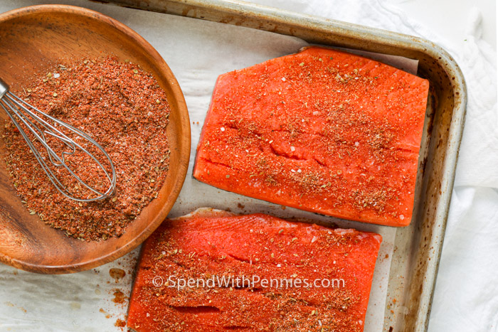 Salmon seasoned on a baking tray